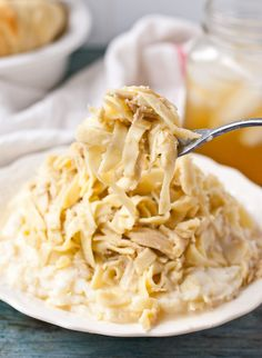 Homemade Amish Chicken and Noodles.These Amish Chicken and Noodles are so silky and so comforting. Serve them the traditional way over mashed potatoes!