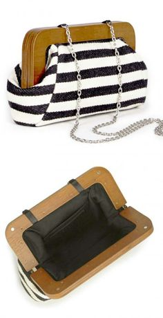 Black & white printed clutch with a wooden frame and chain link shoulder strap