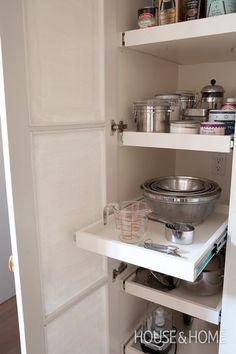 Lynda Reeves' Kitchen Supply Closet  Keep cooking fun with bowls, gadgets and pantry supplies that are easy to find.   Lynda's supply closet features another must-have: practical pull-out shelves for easy access to small appliances and baking supplies.