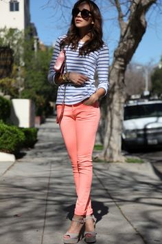 neon coral jeans and striped long sleeve shirt