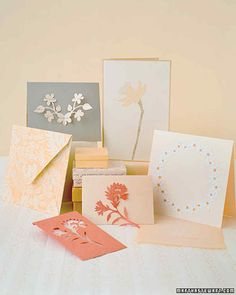 Floral Paper Cutout Cards   Martha Stewart Living - Intricate flowers are cut out of paper and pasted onto these lovely cards.