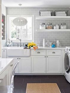A whole lot more than laundry happens in this hardworking space. With great light, soft finishes, and tons of storage, it's a place to linger.