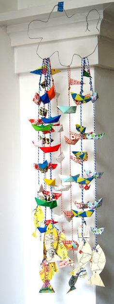 summer activities, School Agers paint and decorate boats and fish, then they get put up like this for parents to see at the front entrance. (Also a decorating idea)
