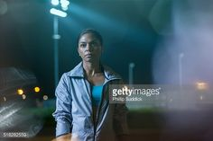 Portrait Of A Female Urban Runner At Night Stock Photo | Getty Images