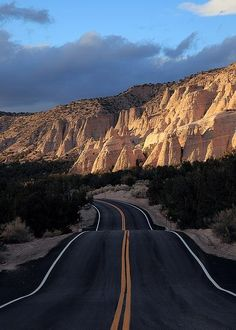 New Mexico Looks like the road to Ghost Ranch.... Georgia O'Keefe....although many roads out there look like this.