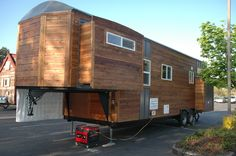 This 34' RVIA-certified tiny 5th wheel house built on a gooseneck trailer has three slide outs that dramatically increase living space and comfort.