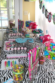 Cute Girl Birthday Party love the  bright colors with the zebra..  but the table cloth is a little much... just adding a bit of zebra would be cute.