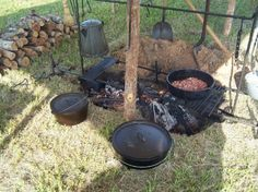 Cast Iron Dutch oven cooking over a trench --  Chuck Wagon Cooking -- cowboycooking dot com
