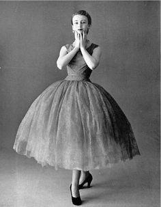 1951 Model in eye-catching fuschia, Chantilly lace dance dress, by Marcel Rochas,