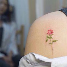 Realistic small tattoo flower