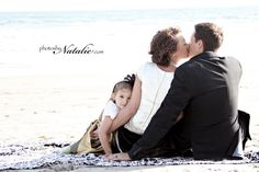 Love the arrangement of this family shot.  And of course the beach background is lovely.