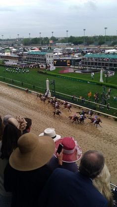 HERE is view from Millionaires Row at Churchill Downs as KY Dby field passes by Finish Line for first time.