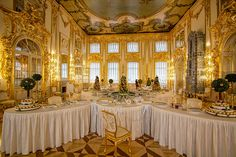 Marzipan displays decorate lavishly set tables in the large dining room of Catherine Palace, St. Petersburg, Russia