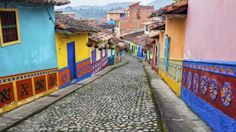 Travel through four diverse areas of Colombia including Bogota, Villa de Leyva, the Coffee Zone and Cartagena. Colombian Slang, Colombian Art, Lonely Planet, American Village, American Country, Round The World Trip, Moving Overseas, Cheap Places To Travel, South American Countries