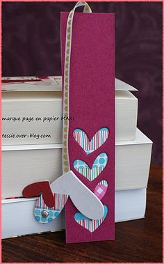a bookmark made of recycled paper but could be 2 layers of felt with cloth in the middle.