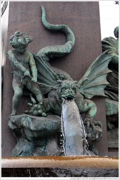 Dragon-dog figure on fountain outside Zürich Hauptbahnhof (Main Station). Altstadt (Old Town).