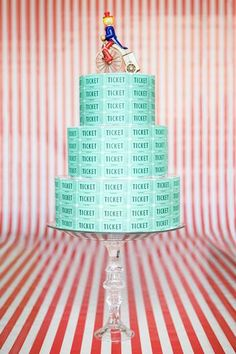 """Big Top Baby: ticket-covered hat box """"cake""""...top layers have red-white stripe paper"""