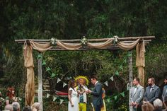 Huge burlap and floral arbor.  Worth every step in the ladder! #veganwedding