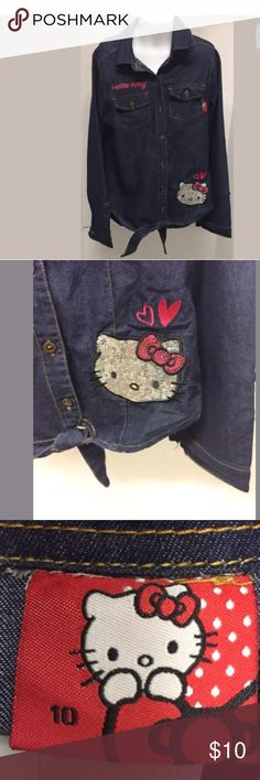 🐱Hello Kitty Girl's Denim Shirt with Sequins SZ10 Hello Kitty Denim Shirt with Silver Sequins Size:10  Color: Blue Good Condition   Thank you for viewing this listing! Hello Kitty Shirts & Tops Button Down Shirts