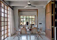 Une salle à manger rétro entre bois et métal