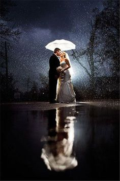 Beautiful rainy wedding day night photo