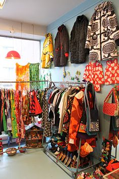 Retro clothes and accessories at Daiga Daiga Duu.  I want those coats on the wall!