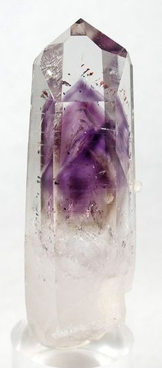 Quartz w. Amethyst phantom from Namibia. Amethyst is a powerful and protective stone.  It guards against negative energy, relieves stress and strain, soothes irritability, balances mood swings, dispels anger, fear and anxiety.  Alleviates sadness and grief.Activates spiritual awareness, opens intuition and enhances psychic abilities. It has strong healing and cleansing powers.