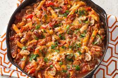 This pasta dish—full of fresh vegetables, ground beef, cheese and bacon—isn't…