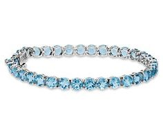 Swiss Blue Topaz Bracelet in Sterling Silver - I used to have a similar one of these in gold and a different cut of stone. My late husband bought it for me in Hawaii. Ex-Boyfriend Joe stole it.  DOUCHE