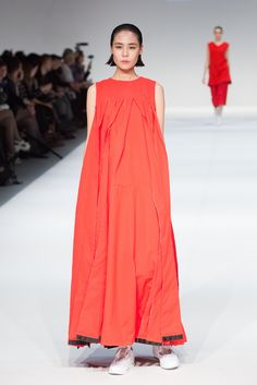 LOOK 1 designed by Tsang Fan Yu, The EcoChic Design Award 2015/16 finalist – Up-cycled red tasseled dress made from end-of-roll textiles #Redress #ECDA #EcoChicDesignAwards #SustainableFashion #TsangFanYu