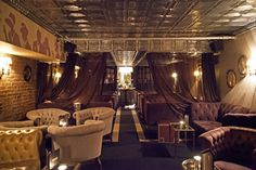 Raines Law Room  On a nondescript block in Chelsea, Raines Law Room is a hidden gem resembling a sophisticated Victorian parlor. Ring the bell and a butler will admit you into the lounge, which features tufted velour sofas, damask wallpaper, a fireplace, and antique mirrors—the perfect backdrop to savor a few classic cocktails. raineslawroom.com