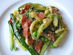 Zuccini Carbonara Recipe- zuccini, bacon, peas... Because I have zucchini coming out my ears!  I might figure out a lighter version.