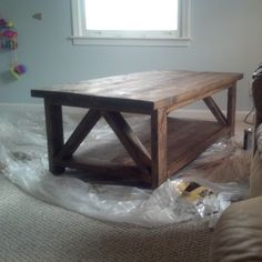 Rustic X mixed with a Triple Truss Coffee Table   Do It Yourself Home Projects from Ana White