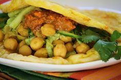 """A flavourful vegetarian bite (roti, chickpeas, cucumber pickle):  'This incredible """"Doubles"""" recipe from Trinidad and Tobago'"""