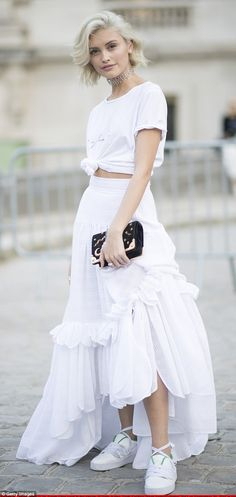 The queen of street style: Sarah Ellen, 18, cut a casual-chic figure in a floor-length lace skirt, T-shirt, and sneakers on Thursday while at Paris Fashion Week
