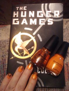 My creation Inspired by The Hunger Games! The glitter polish is from China Glaze's Hunger Games Nail Polish collection and the orange polish is Sinful Colors