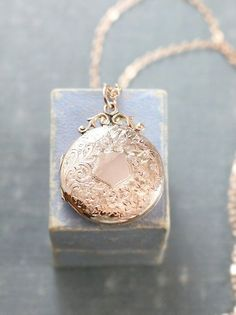 A gorgeous 100 year old Edwardian rose gold locket is hand engraved with an intricate pattern of flowers and swirls with a classic shield like center necklace silver necklake necklake necklace necklace for girlfriends pendant set wrapped pendant necklace Rose Gold Locket, Silver Lockets, Cute Jewelry, Gold Jewelry, Jewelry Accessories, Jewellery Box, Jewellery Shops, Tanishq Jewellery, Jewellery Earrings