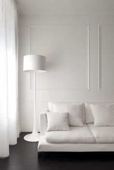 Luxuriate in the Living Room. White walls, dark floors, and boiserie wall moulding. Modern Floor Lamps, House Design, Interior, Interior Inspiration, Home, Decor Interior Design, House Interior, White Floor Lamp, White Walls