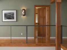 Aluminum railing with horizontal cable infill in residential interior:DesignRail® 2nd floor