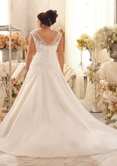 Venice Lace Appliques on Net with Crystal Beaded Trim Plus Size Wedding Dress. Colors available: White/Silver and Ivory/Silver. Sizes Available: 16W-28W.
