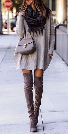 Women's gray long sleeve dress and pair of brown knee-high boots