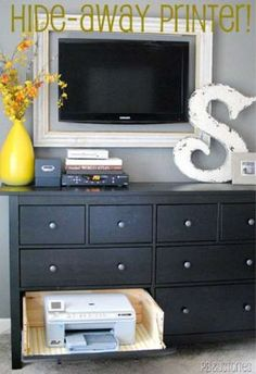 When you put the front of a dresser drawer on a hinge, you can keep your printer hidden away