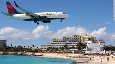 """A Different Kind of Happy Hour:  Customers at the Sunset Bar & Grill on Maho Beach """"go crazy,"""" when the big planes fly overhead, says bar employee Dianne Carbon. """"When they're taking off or coming in -- it's almost like it was an earthquake."""""""