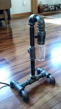 table lamp out of black pipe w/ usb charger