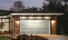Garage door Clopay Avante with clear anodized aluminum frame, white laminate glass full view.