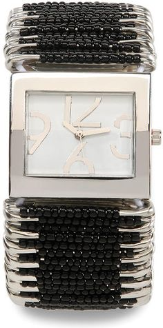Spice up your outfit with this unique stretchy safety pin watch. Each safety pin is decorated with tiny black beads.