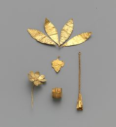 Group of ornaments, pendant in the form of a leaf.    Early Minoan II–III  Date:     ca. 2300–2100 B.C.  Culture:     Minoan  Medium:     Gold