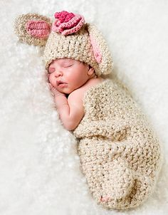 This cocoon and bunny hat set was made with soft premium textured yarn in a great natural creamy color. The bunny hat has rose pink inside the ears. The bunny also comes with a rose pink & darker rose boutique flower - which is on a clip so it can be repositioned, removed, or used on other things. If you would prefer a different colored flower of a knitted blue bow or blue or brown inside the ears just let me know and it will be no problem. This works great as a set and the hat is also fun…