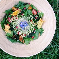 #gardentotable salad for lunch.  Kale, spinach, beet top seedlings, tomatoes, cucumber, zucchini, carrots, alfalfa sprouts, borage flowers, ...
