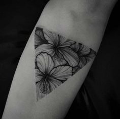 Soft colorless flowers fit elegantly into a triangular glyph, so beautiful! Back of neck maybe?